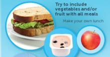 Image of a homemade lunch - wholegrain sandwich with lettuce and tomato, a pottle of yoghurt with blueberries and an apple
